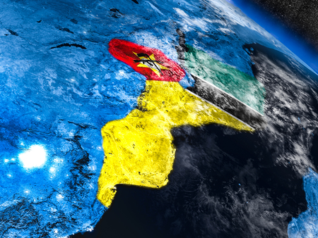 Mozambique with embedded national flag at night from space. 3D illustration with detailed planet surface and visible city lights.