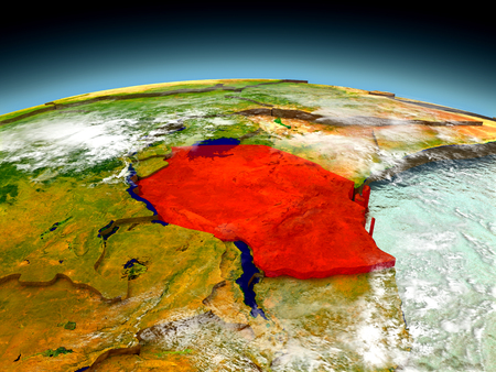 tanzania: Tanzania in red on model of planet Earth as seen from orbit. 3D illustration with detailed planet surface. Elements of this image furnished by NASA. Stock Photo