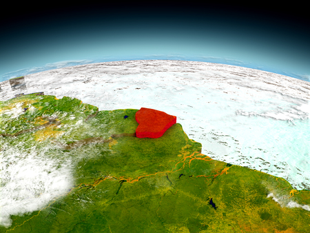 French Guiana in red on model of planet Earth as seen from orbit. 3D illustration with detailed planet surface.