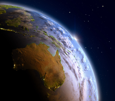 Australia during sunrise from Earths orbit in space. 3D illustration with detailed planet surface and visible city lights.