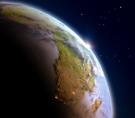 visible: Africa during sunrise from Earths orbit in space. 3D illustration with detailed planet surface and visible city lights.