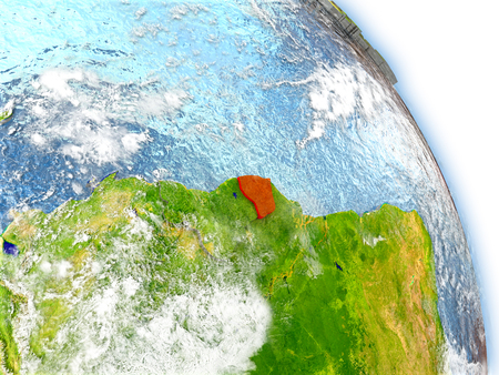 guiana: French Guiana in red color on model of Earth. 3D  illustration with detailed planet surface, clouds and reflective ocean waters.