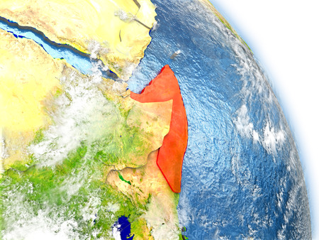 Somalia in red color on model of Earth. 3D  illustration with detailed planet surface, clouds and reflective ocean waters.
