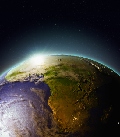 Sun rising above Africa. 3D illustration with detailed planet surface, atmosphere and city lights.