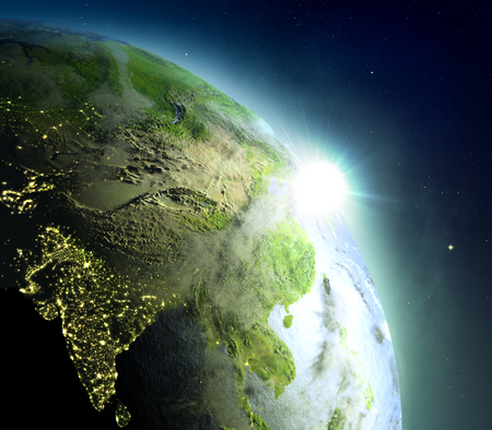 city lights: Sunrise above Southeast Asia. Concept of new beginning, hope, light. 3D illustration with detailed planet surface, atmosphere and city lights.