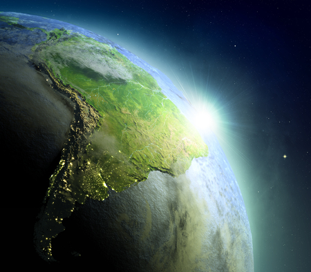 Sunrise above South America. Concept of new beginning, hope, light. 3D illustration with detailed planet surface, atmosphere and city lights. Elements of this image furnished by NASA.