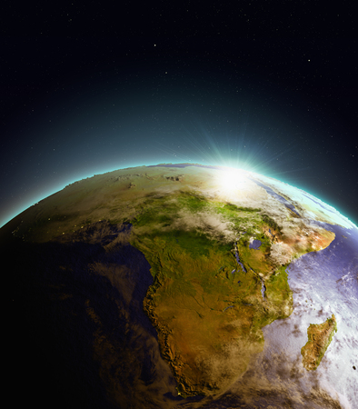 beginnings: Africa from Earths orbit in space just as the sun rises. 3D illustration with detailed planet surface. Elements of this image furnished by NASA.