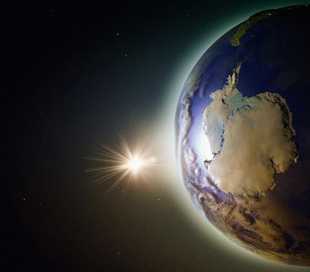 南極領域で地球の軌道から見た夕日。詳細な惑星の表面に 3 D のイラスト。 写真素材