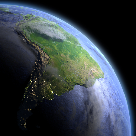 South America in the dark at dawn. 3D illustration with detailed planet surface, atmosphere and visible city lights.