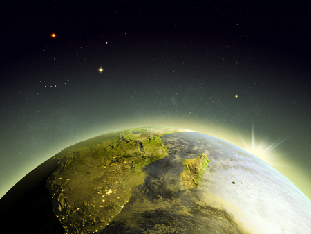 orbiting: Sunrise above South Africa from Earths orbit in space. 3D illustration with detailed planet surface.