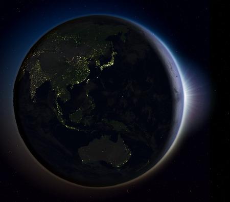 Soleil qui monte au-dessus de l'Asie de l'Est sur la planète Terre vu de l'espace. Illustration 3D avec des lumières réelles de la ville illuminant la surface. Banque d'images - 80620809