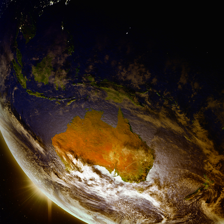 Sunset above Australia as seen from Earths orbit in space. 3D illustration with detailed planet surface.