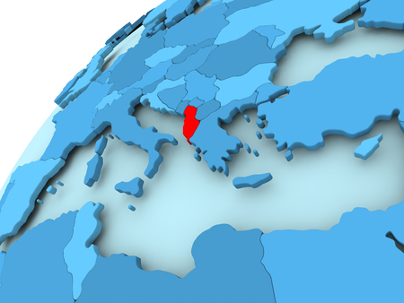 Albania in red on blue model of political globe. 3D illustration.