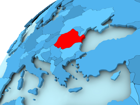 Romania in red on blue model of political globe. 3D illustration.