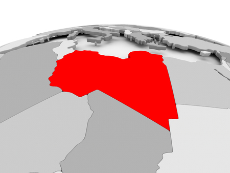 Libya in red on grey model of political globe. 3D illustration. Stock Photo