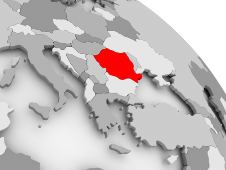 3D render of Romania in red on grey political globe. 3D illustration.