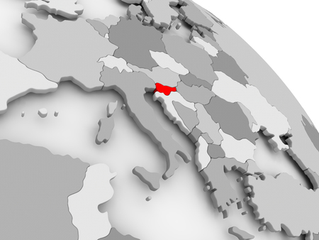 3D render of Slovenia in red on grey political globe. 3D illustration.