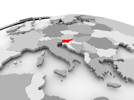 Slovenia in red on grey model of political globe. 3D illustration. 版權商用圖片