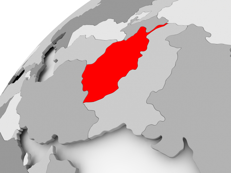 Map of Afghanistan in red on grey political globe. 3D illustration. Stock Photo