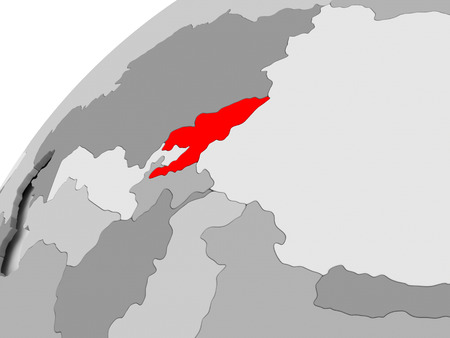 Map of Kyrgyzstan in red on grey political globe. 3D illustration. Stock Photo