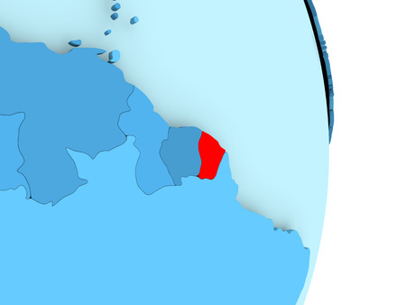 French Guiana in red on simple blue political globe with visible country borders. 3D illustration. Stock Photo