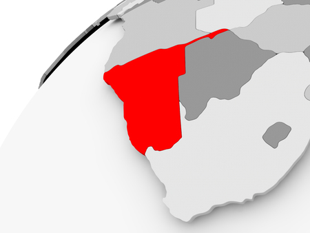 Map of Namibia in red on grey political globe. 3D illustration. Фото со стока