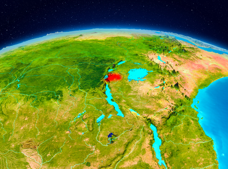 Satellite view of Rwanda highlighted in red on planet Earth. 3D illustration.