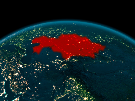 Country of Kazakhstan in red on planet Earth at night. 3D illustration.
