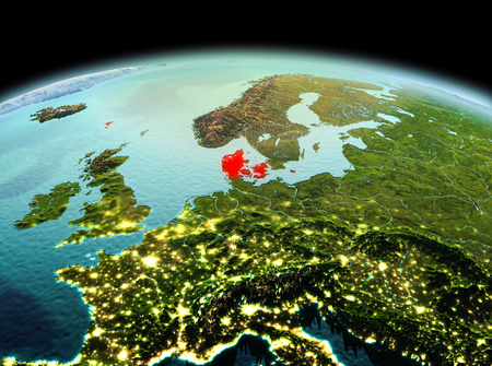Morning above Denmark highlighted in red on model of planet Earth in space. 3D illustration.
