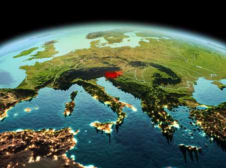 Morning above Slovenia highlighted in red on model of planet Earth in space. 3D illustration. Stock Photo