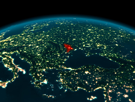 Country of Moldova in red on planet Earth at night. 3D illustration. Stock Photo