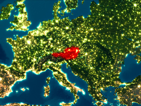 Satellite night view of Austria highlighted in red on planet Earth. 3D illustration.
