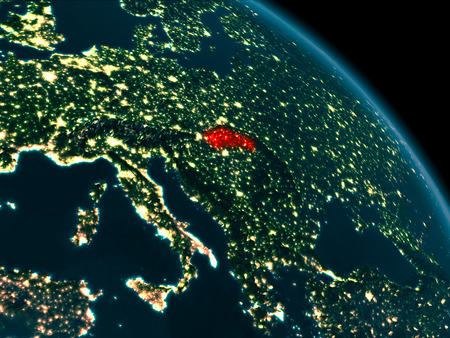 Orbit view of Slovakia at night highlighted in red on planet Earth with highly detailed surface textures. 3D illustration.