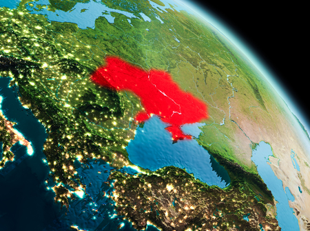 Satellite morning view of Ukraine highlighted in red on planet Earth. 3D illustration.