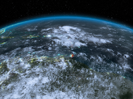 Satellite night view of Caribbean highlighted in red on planet Earth with clouds. 3D illustration.