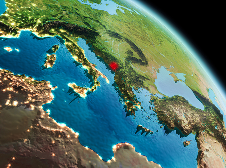 Satellite morning view of Montenegro highlighted in red on planet Earth. 3D illustration.