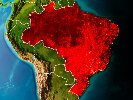 Brazil in the morning highlighted in red on planet Earth with visible border lines and city lights. 3D illustration.