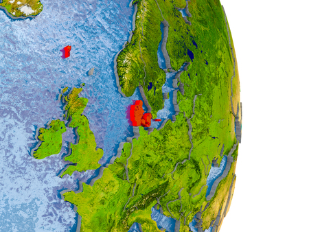 Denmark in red on model of globe with embossed countries and realistic water. 3D illustration. Stock Photo