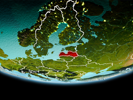 Country of Latvia in red on planet Earth in the evening with visible border lines and city lights. 3D illustration.