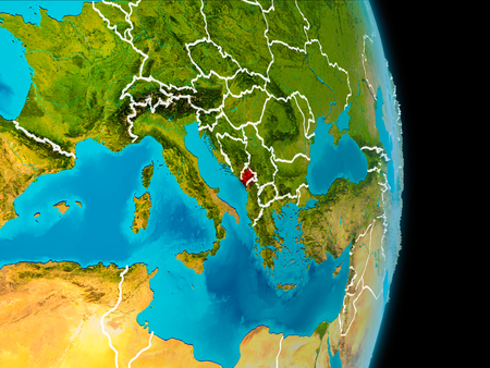 Montenegro in red on planet Earth with visible borderlines. 3D illustration.
