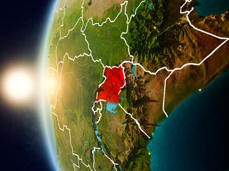 Illustratie van Oeganda zoals die van de baan van de Aarde tijdens zonsondergang met zichtbare landgrenzen wordt gezien. 3D illustratie. Stockfoto