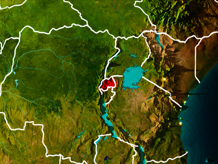 Rwanda in the morning highlighted in red on planet Earth with visible border lines and city lights. 3D illustration.