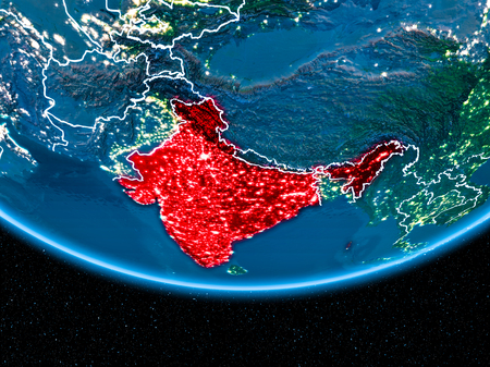 India in red with visible country borders and city lights from space at night. 3D illustration.