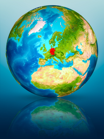 Germany in red on model of planet Earth on reflective blue surface. 3D illustration.