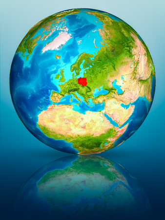 Poland in red on model of planet Earth on reflective blue surface. 3D illustration.