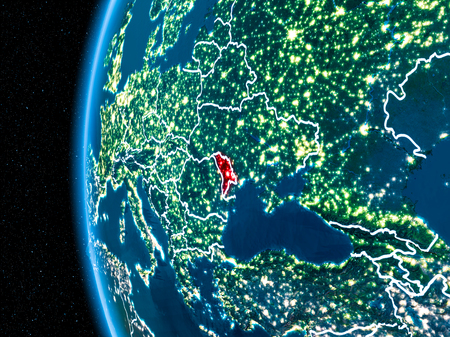 Space orbit view of Moldova highlighted in red on planet Earth at night with visible country borders and city lights. 3D illustration. Stock Illustration - 91256516