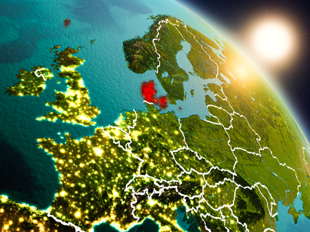 Sunset above Denmark from space on planet Earth with visible country borders. 3D illustration.