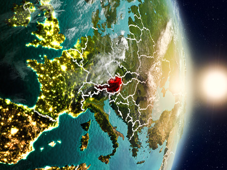 Austria during sunrise highlighted in red on planet Earth with visible country borders. 3D illustration.