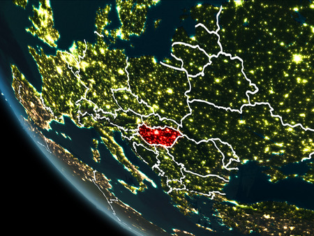 Satellite view of Hungary highlighted in red on planet Earth at night with borderlines and city lights. 3D illustration.