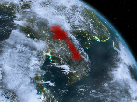 Night above Laos highlighted in red on model of planet Earth in space. 3D illustration. Stock Photo
